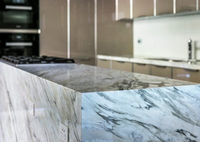 Rose Bay Residence With Calacatta Marble Kitchen Island and ONYX Bar