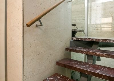 Rosso-Lepanto-Step-treads-and-travertine-navona-lift-surround