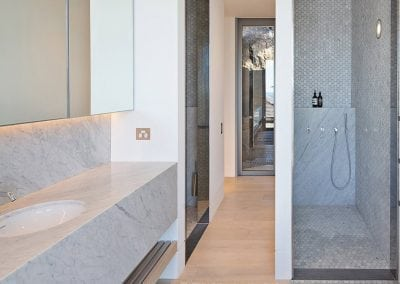 Carrara-marble-vanity-and-shower-walls