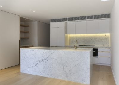 Carrara-marble-kitchen-island-and-splashback