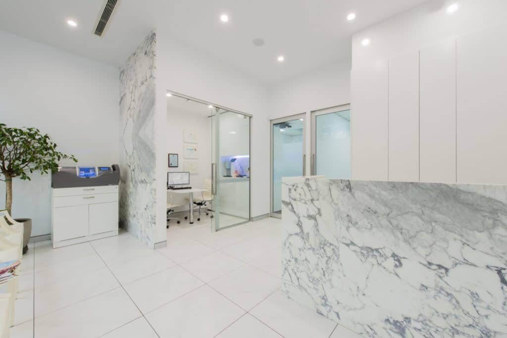 arabescato marble dentist counter feature wall