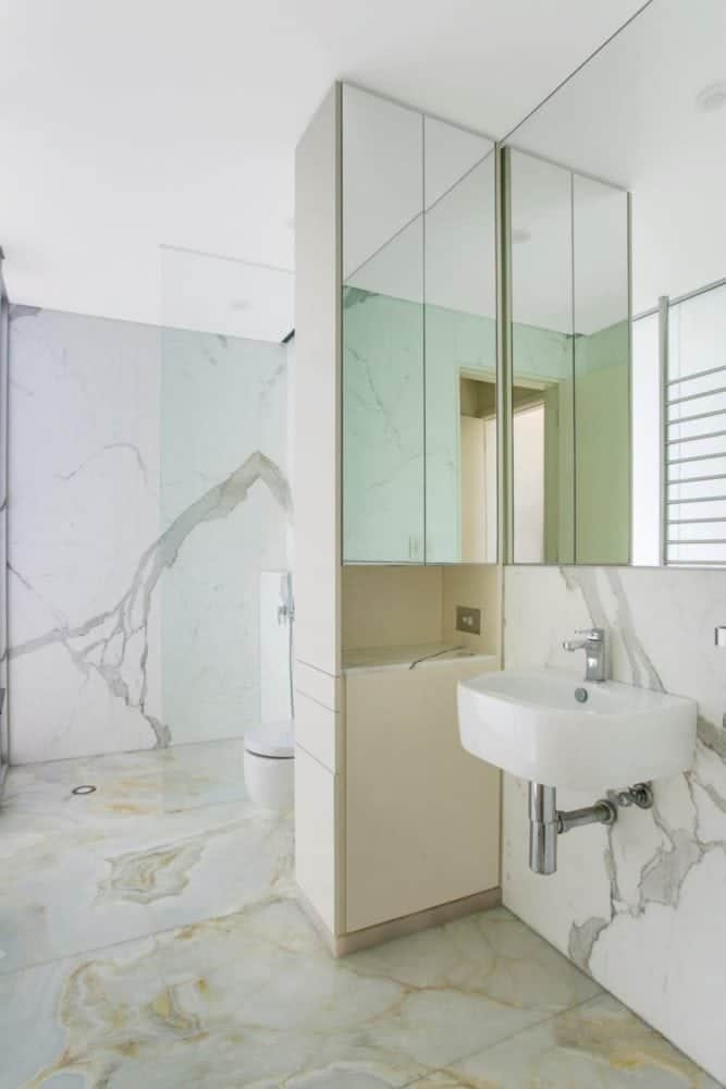 calacatta marble ensuite walls and white onyx floor