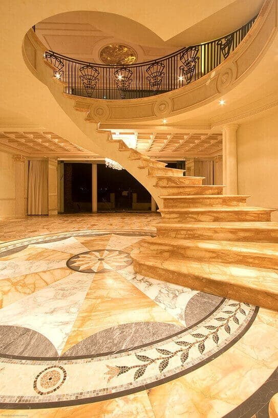 giallo sienna marble entry foyer and staircase