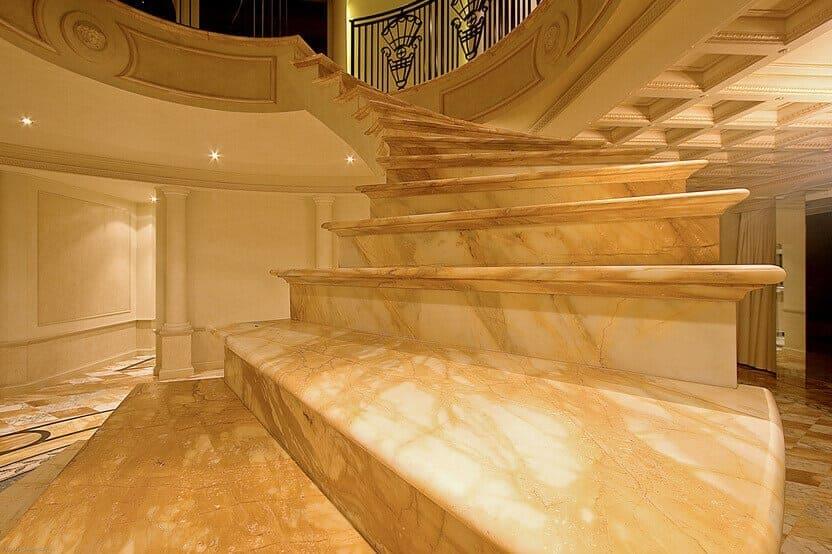 giallo sienna marble spiral staircase