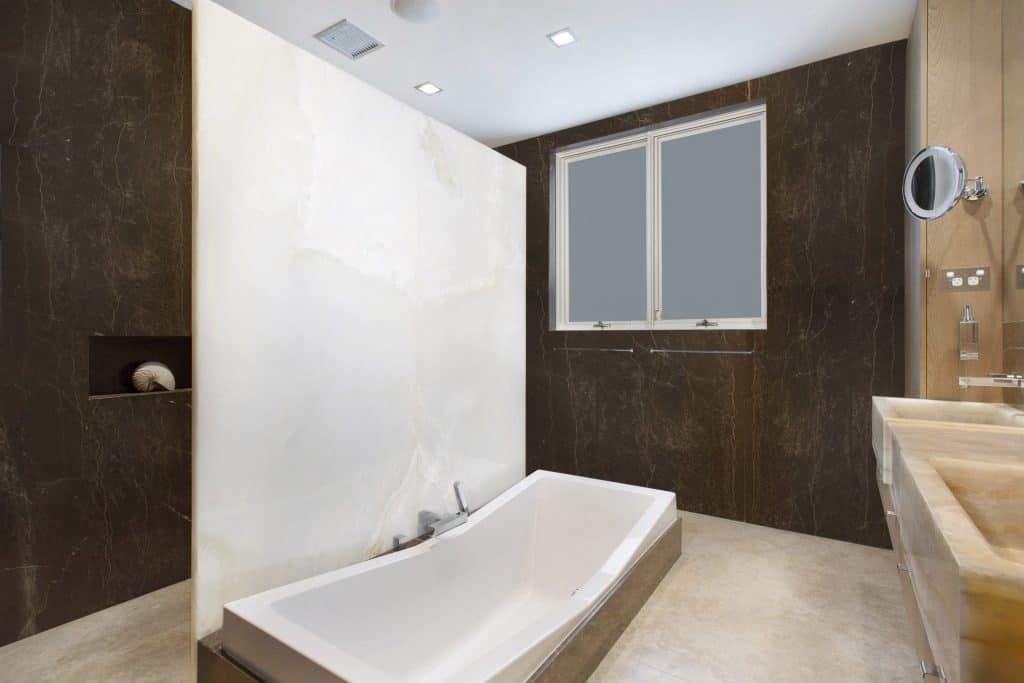 white onyx bathroom feature wall